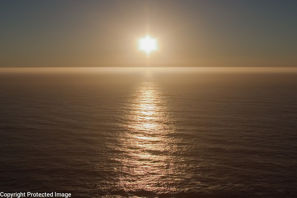 Sun setting over pacific ocean, Big Sur, California