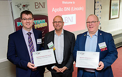 BNI Apollo's chapter president Simon Meadows (Sterling Business Coaching), centre, presents the chapters latest notable networker certificates to Michael Jones (DCP), left, and Andy Oxborrow (Utility Warehouse).  BNI Apollo (Lincoln) meet at Lincoln City Football Club on Thursday mornings (9.15am - 11am).<br /> <br /> Picture: Chris Vaughan Photography<br /> Date: December 7, 2017