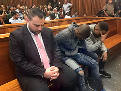 Christopher Panayiotou, Sinethemba Nenembe and Zolani Sibeko listen as judgement is handed down in the Port Elizabeth High Court on Thursday. PHOTO: Raahil Sain/ANA
