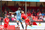 Cawley Town player Romain Vincelot and Stevenage player Alex Revell fight for the ball in the second half during the EFL Sky Bet League 2 match between Crawley Town and Stevenage at the Checkatrade.com Stadium, Crawley, England on 11 August 2018.