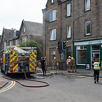 Firefighters outside a property on Priory Place in Perth after a fire broke out around 1.30pm this afternoon...16.07.13  It is believed that the cause of the fire was a chip pan.<br /> Picture by Graeme Hart.<br /> Copyright Perthshire Picture Agency<br /> Tel: 01738 623350  Mobile: 07990 594431