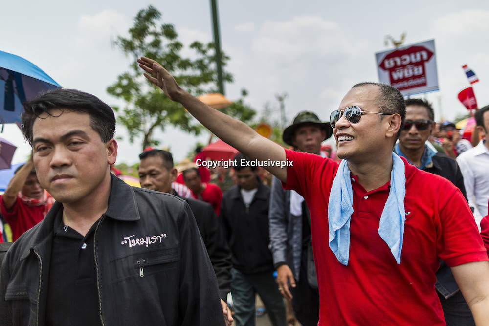 April 6, 2014 - Bangkok, Bangkok, Thailand - <br /> <br /> Red Shirts Rally in Bangkok Suburbs<br /> <br /> NATTAWUT SAIKUA, a Red Shirt core leader, walks through the crowd at a Red Shirt rally in a Bangkok suburb Sunday. Red Shirts and supporters of the government of Yingluck Shinawatra, the Prime Minister of Thailand, gathered in a suburb of Bangkok this weekend to show support for the government. The Thai government is dealing with ongoing protests led by anti-government activists. Legal challenges filed by critics of the government could bring the government down as soon as the end of April. The Red Shirt rally this weekend was to show support for the government, which public opinion polls show still has the support of most of the electorate.<br /> &copy;Exclusivepix