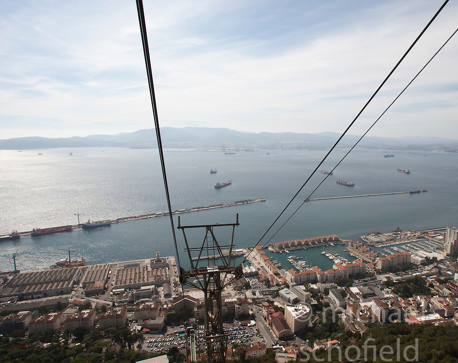 The Gibraltar Cable Car. Photographs from the top of the Rock of Gibraltar. Images of Gibraltar, the British overseas territory located on the southern end of the Iberian Peninsula at the entrance of the Mediterranean.