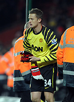 Anders Lindegaard Throws his Gloves in to the crowd after the final whistle and then picks up a Man United Scarf for a souvenir<br />Manchester United 2010/11<br />Southampton V Manchester United (1-2) 29/01/11 <br />The FA Cup 4th Round<br />Photo: Robin Parker Fotosports International
