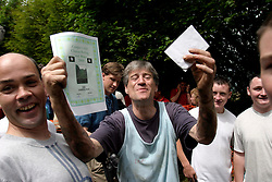 UK ENGLAND COOPERS HILL 31MAY04 - 3rd placed Stephen Arthur Gyden poses with his certificate and prize after he threw himself off the top of a steep 200-metre slope in pursuit of a 7-pound Cloucester Cheese. The cheese rolling is one of the oldest customs to have survived some saying, for hundreds of years, even pre-Roman times. The ceremony is reported to.have taken place originally at midsummer and to have been moved to Whitsun in early Saxon times. Some say it is a relic of an old heathen festival to celebrate the return of spring and.others say, when held in midsummer, it represented the waning of the sun as summer reached its height, but no one knows for sure....jre/Photo by Jiri Rezac..© Jiri Rezac 2004..Contact: +44 (0) 7050 110 417.Mobile:  +44 (0) 7801 337 683.Office:  +44 (0) 20 8968 9635..Email:   jiri@jirirezac.com.Web:     www.jirirezac.com