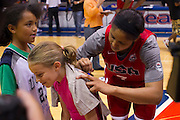 Maya Moore signs a fan's shirt after the 2012 USA Women's Basketball team practice at Bender Arena  in Washington, DC.  July 15, 2012  (Photo by Mark W. Sutton)