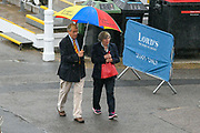 Spectators arrive in the rain under umbrellas ahead of the International Test Match 2019 match between England and Australia at Lord's Cricket Ground, St John's Wood, United Kingdom on 14 August 2019.
