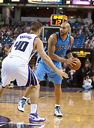 October 23, 2009; Sacramento, CA, USA;  Utah Jazz forward Carlos Boozer (5) is guarded by Sacramento Kings forward Jon Brockman (40) during the third quarter at the ARCO Arena.  The Jazz won 95-85.