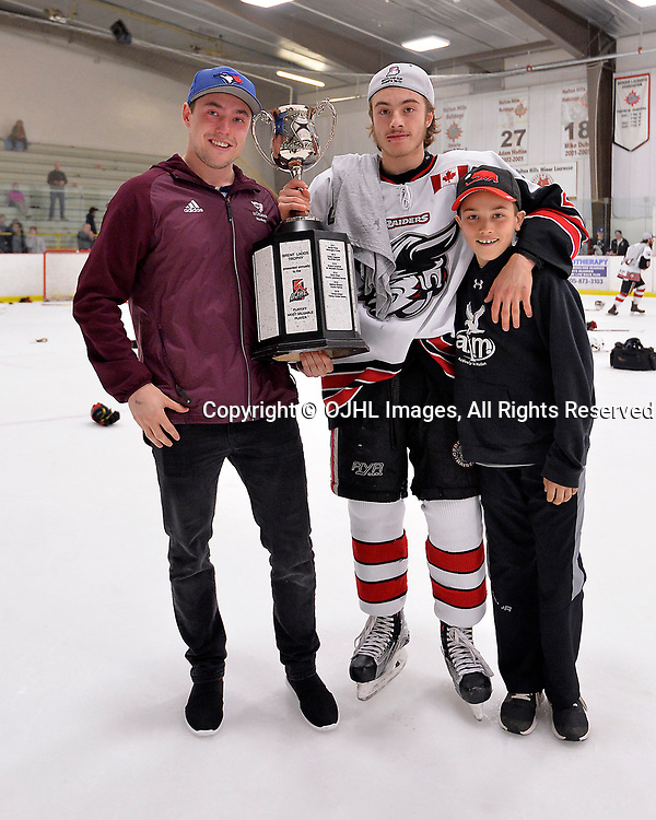 GEORGETOWN, ON  - APR 26,  2017: Ontario Junior Hockey League, Championship Series.  Georgetown Raiders vs the Trenton Golden Hawks in Game 7 of the Buckland Cup Final.  Jack Jacome #23 of the Georgetown Raiders celebrates his Playoff MVP award with his brothers.<br /> (Photo by Shawn Muir / OJHL Images)