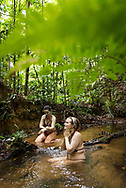 Manaus, Amazonia, Brazil, November 2018.  Getting cleaned up in a jungle creek after exploring the Amazone Rainforest with Leo and Vanessa of Amazon Emotions. The Amazone river and Rio Negro connect the small rain forest communities that dot the region. River Amazon (Portuguese: Rio Amazonas; Spanish: Río Amazonas) of South America is the largest river in the world by volume, with total river flow greater than all the other top ten largest rivers flowing into the ocean combined. The Amazon drains an area of some 6,915,000 square kilometres (2,670,000 sq mi), or some 40 percent of South America. Photo by Frits Meyst / MeystPhoto.com