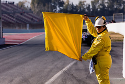 February 18, 2019 - Montmelo, BARCELONA, Spain - Marshal with the yellow flag during the Formula 1 2019 Pre-Season Tests at Circuit de Barcelona - Catalunya in Montmelo, Spain on February 18. (Credit Image: © AFP7 via ZUMA Wire)