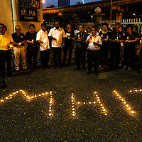 Malaysian opposition party members light up candle during a candlelight vigil for passengers and crew of the Malaysian Airline crash flight MH17 in Kuala Lumpur,  Malaysia, 19 July 2014. International observers were to mount another attempt 19 July to gain access to the crash site of a Malaysia Airlines passenger plane in eastern Ukraine, after being hindered by pro-Russian armed separatists.