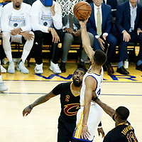 12 June 2017: Golden State Warriors guard Stephen Curry (30) goes for the layup past Cleveland Cavaliers center Tristan Thompson (13) during the Golden State Warriors 129-120 victory over the Cleveland Cavaliers, in game 5 of the 2017 NBA Finals, at the Oracle Arena, Oakland, California, USA.