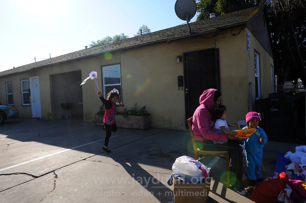 Children play at a yard sale along N. Hebbron Avenue, part of the CASP coverage area. Officers Lofton and Lopez know virtually all the families in this neighborhood.