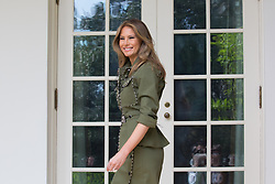 April 27, 2017 - Washington, District of Columbia, United States - First Lady  MELANIA TRUMP walks through the West Wing Colonnade to the Oval office, of the White House in a military-inspired Altuzarra suit with snake-stamped trim, one day after her 47th birthday. (Credit Image: © Cheriss May/NurPhoto via ZUMA Press)