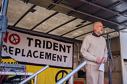 © Licensed to London News Pictures. 24/01/2015. Westminster, UK.  Jeremy Corbyn MP gives a speech to demonstrators in central London as they stage a mass protest against government plans to spend £100 billion replacing Trident, the UK's Cold War nuclear weapons system.  They encircled government and parliament buildings with a peace scarf knitted by thousands of people. Photo credit : Stephen Chung/LNP
