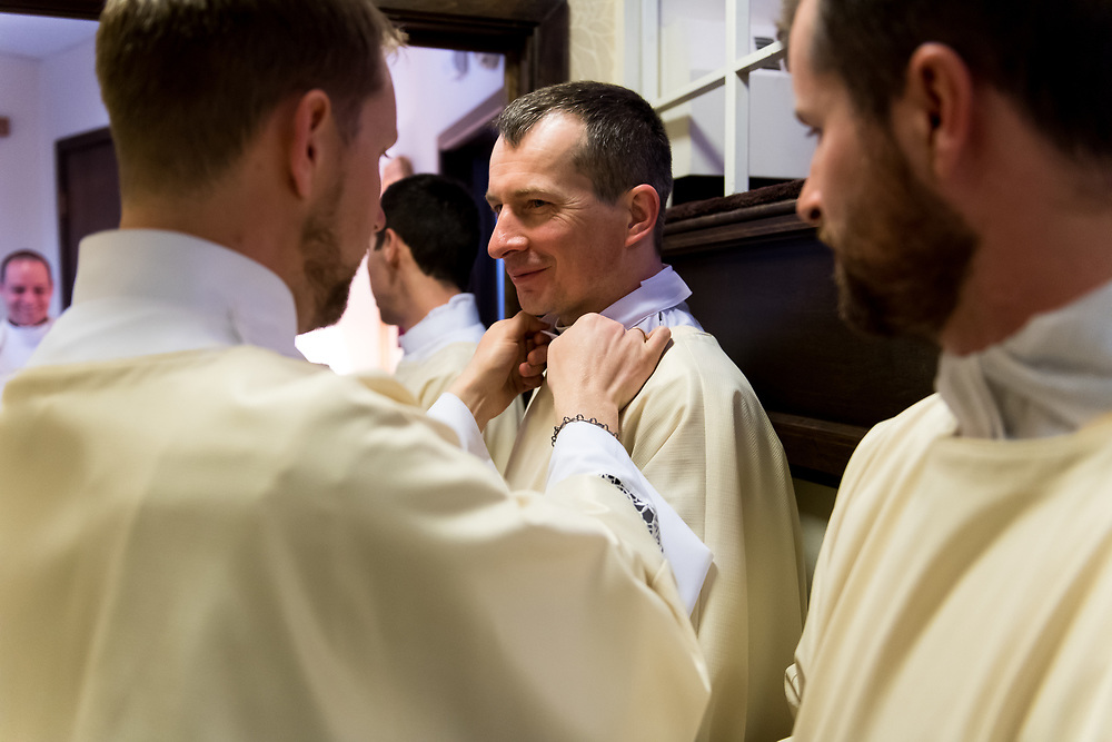 DENVER, CO - MAY 13: Daniel Ciucci helps Bogusław Rębacz with his collar before their ordination to the priesthood at the Cathedral Basilica of the Immaculate Conception on May 13, 2017, in Denver, Colorado. (Photo by Daniel Petty/for Denver Catholic)
