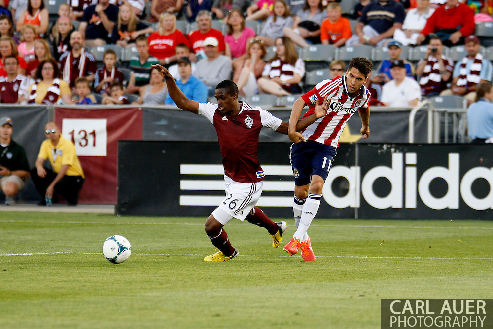 May 25th, 2013 Commerce City, CO - Colorado Rapids forward Deshorn Brown (26) is pulled to the ground by Chivas USA midfielder Gabriel Farfan (11) as they battle for the ball in the first half of the MLS match between Chivas USA and the Colorado Rapids at Dick's Sporting Goods Park in Commerce City, CO