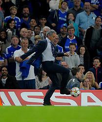 Chelsea Manager, Jose Mourinho retrieves the ball  - Photo mandatory by-line: Joe Meredith/JMP - Mobile: 07966 386802 - 17/09/2014 - SPORT - FOOTBALL - London - Stamford Bridge - Chelsea v Schalke 04 - Champions League Group Stage
