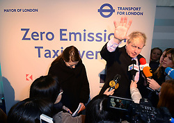 The Mayor of London, Boris Johnson, announces plans for a challenging taxi emission target and attends a 'New Taxis for London' event which saw manufacturers, from Fraser Nash, Karsan and The London Taxi Company, show casing greener taxis of the future, that will deliver the iconic service that London is famed for whilst minimising harmful emissions, at Potters Field, City Hall, London, United Kingdom. Thursday, 16th January 2014. Picture by Nils Jorgensen / i-Images