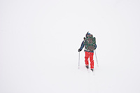 Skiing down the Sky Top Lakes valley in a white out.  Beartooth Mountains, Montana.