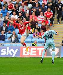 Bristol City's Joe Bryan battles for the high ball with Coventry City's Aaron Phillips  - Photo mandatory by-line: Joe Meredith/JMP - Mobile: 07966 386802 - 18/10/2014 - SPORT - Football - Coventry - Ricoh Arena - Bristol City v Coventry City - Sky Bet League One