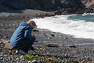 A woman explores one of the many beaches at Mendocino Headlands State Park, California