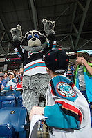 KELOWNA, CANADA - OCTOBER 23: Rocky Racoon, the mascot of the Kelowna Rockets hams it up with young fans in the stands on October 23, 2015 at Prospera Place in Kelowna, British Columbia, Canada.  (Photo by Marissa Baecker/Shoot the Breeze)  *** Local Caption *** Rocky Racoon; fans;