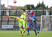 Luke Croll heading clear the danger during the U21 Professional Development League match between Crystal Palace U21s and Huddersfield U21s at Imperial Fields, Tooting, United Kingdom on 7 September 2015. Photo by Michael Hulf.