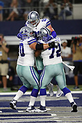 Dallas Cowboys tight end Jason Witten (82) leaps and celebrates with Dallas Cowboys guard Zack Martin (70) and Dallas Cowboys center Travis Frederick (72) after catching a 10 yard touchdown pass for a 10-6 second quarter Cowboys lead during the 2017 NFL week 3 preseason football game against the Oakland Raiders, Saturday, Aug. 26, 2017 in Arlington, Tex. The Cowboys won the game 24-20. (©Paul Anthony Spinelli)