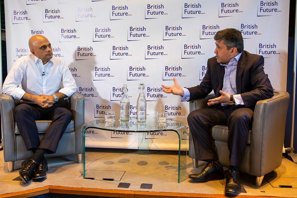Sajid Javid MP discussing the challenges of identity in British society today, in conversation with Sunder Katwala, Director of thinktankBritish Future at The Royal Society London, United Kingdom, 6th June 2019.  Home Secretary Sajid Javid is the first British Asian politician to hold one of the great offices of state. He has declared that he will be a candidate to be the next Prime Minister in the forthcoming Conservative leadership election. (photo by Andy Aitchison)