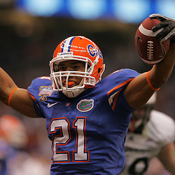 Jan 01, 2010; New Orleans, LA, USA;  Florida Gators running back Emmanuel Moody (21) celebrates as he runs for a touchdown against the Cincinnati Bearcats for a touchdown during the first half of the 2010 Sugar Bowl at the Louisiana Superdome.  Mandatory Credit: Derick E. Hingle-US PRESSWIRE.