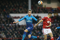 Arsenal's Rob Holding (C)  heads away from Ben Brereton  during The Emirates FA Cup Third Round match between Nottingham Forest and Arsenal at City Ground on January 7, 2018 in Nottingham, England.