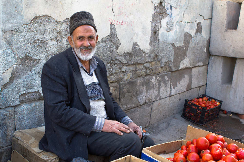 A tomato seller at the famous local bazaar, a Unesco World Heritage site (Tabriz, Iran, 2012).<br /> <br /> Licensed by Tandem Stills + Motion (2013).<br /> <br /> Available here: https://tandemstock.com/assets/79350136