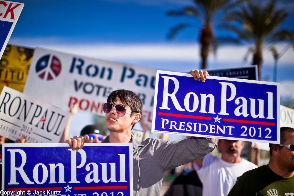 22 FEBRUARY 2012 - MESA, AZ:  HAROLD SMITH, from Scottsdale, AZ, rallies in support of Ron Paul in Mesa, AZ, Wednesday. Ron Paul supporters had hundreds of people in front of the Mesa Arts Center before CNN's Arizona Republican Presidential Debate Wednesday.    PHOTO BY JACK KURTZ