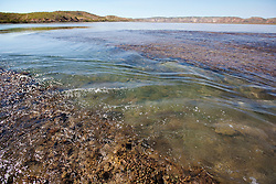 Water flows down a channel on Turtle Reef in Talbot Bay as the tide falls.  Turtle Reef is a massive fringing reef complex  linking islands with the mainland.