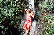 Woman under Waterfall, Nuuanau, Honolulu, Oahu, Hawaii