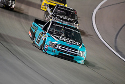 March 1, 2019 - Las Vegas, Nevada, U.S. - LAS VEGAS, NV - MARCH 01: Johnny Sauter (13) ThorSport Ford F-150 racing during the Gander Outdoors Truck Series Strat 200 race on March 1, 2019, at Las Vegas Motor Speedway in Las Vegas, NV. (Photo by David Allio/Icon Sportswire) (Credit Image: © David Allio/Icon SMI via ZUMA Press)