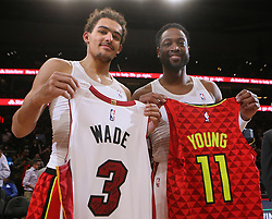 January 6, 2019 - Atlanta, GA, USA - Atlanta Hawks guard Trae Young and Miami Heat guard Dwyane Wade exchange jerseys at the end of the game on Sunday, Jan. 6, 2019 at State Farm Arena in Atlanta, Ga. The Hawks beat the Heat, 106-82. (Credit Image: © Curtis Compton/Atlanta Journal-Constitution/TNS via ZUMA Wire)