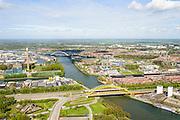 Nederland, Utrecht, Utrecht, 09-04-2014; Lage Weide met in de voorgrond <br /> Hoge Weidebrug (Hogeweidebrug) ook De Gele Brug over het Amsterdam-Rijnkanaal. Rechts Douwe Egbrets, koffieeefabriek. Vleutenseweg. In de achtergrond de Werkspoorbrug.<br /> Bridge crossing Amsterdam-Rhine channell.<br /> luchtfoto (toeslag op standard tarieven);<br /> aerial photo (additional fee required);<br /> copyright foto/photo Siebe Swart