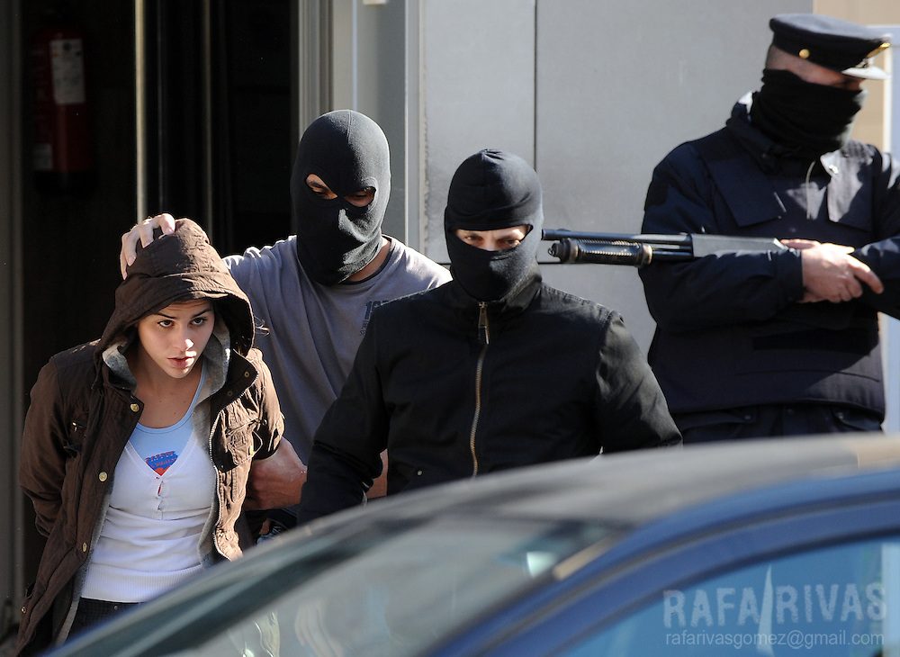 An unidentified suspect of being a member of pro-independence young Basque association SEGI is taken into a police-car after her arrest, on November 24, 2009, in the northern Spanish Basque city of San Sebastian. 36 people were arrested by Spanish National Police during an anti-terrorist operation, in the Basque Country and Navarra, ordered by Spanish judge Grande Marlaska. PHOTO/Rafa Rivas