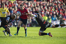 December 9, 2018 - Limerick, Ireland - JJ Hanrahan of Munster tackled by Antoine Tichit and Jody Jenneker of Castres during the Heineken Champions Cup Round 3 match between Munster Rugby and Castres Qlympique at Thomond Park Stadium in Limerick, Ireland on December 9, 2018  (Credit Image: © Andrew Surma/NurPhoto via ZUMA Press)