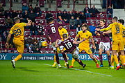 Steven MacLean (#18) of Heart of Midlothian FC scores the equalising goal during the Ladbrokes Scottish Premiership match between Heart of Midlothian FC and Livingston FC at Tynecastle Park, Edinburgh, Scotland on 4 December 2019.
