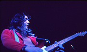 Tommy Bolin at the Armadillo World Headquarters, 1976. Tommy Bolin was an American-born guitarist best known for his work with Zephyr, the James Gang, Deep Purple and his solo work. Bolin died in 1976 at age 25. The Armadillo World Headquarters was a legendary club in Austin Texas that was torn down in 1981.
