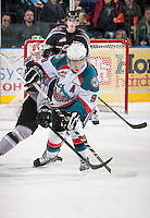 KELOWNA, CANADA - FEBRUARY 2: Zach Franko #9 of the Kelowna Rockets is stick checked on the ice by a member of the Vancouver Giants at the Kelowna Rockets on February 2, 2013 at Prospera Place in Kelowna, British Columbia, Canada (Photo by Marissa Baecker/Shoot the Breeze) *** Local Caption ***