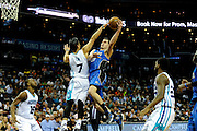 Orlando Magic guard Mario Hezonja shoots against Charlotte Hornets' Jeremy Lin during the second half of an NBA basketball game in Charlotte, N.C., Wednesday, March 16, 2016. (AP Photo/Mike McCarn)