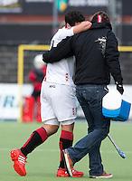 AMSTELVEEN - HOCKEY -  Valentin Verga van Amsterdamn raakt geblesseerd  tijdens de EHL K.O. hockeywedstrijd tussen  de mannen van Amsterdam en het Spaanse Atletic Terrassa . COPYRIGHT KOEN SUYK