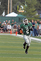12 October 2013:  Devonte Jones finds a huge hole in the middle then heads for the sidelines and the goal line during an NCAA division 3 football game between the North Park vikings and the Illinois Wesleyan Titans in Tucci Stadium on Wilder Field, Bloomington IL