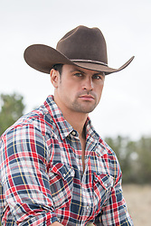 portrait of a cowboy with green eyes outdoors