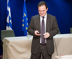 George Papaconstantinou, Greece's finance minister, checks his mobile phone before the start of a press conference following the first meeting of the Van Rompuy task force on economic governance, in Brussels, Belgium, on Friday, May 21, 2010. (Photo © Jock Fistick)